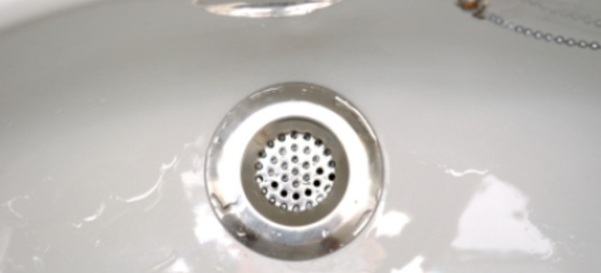 My drain is blocked when should I call a plumber